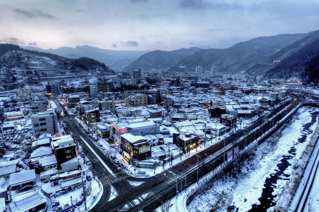 Views from rooftops can make even the most modest town look amazing. This photo shows all the roofs covered in snow in the mountain town of Taebak.