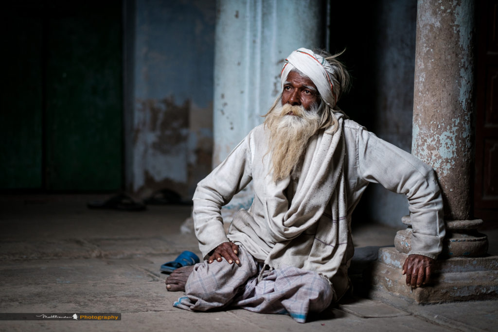 A Muslim, Faquir or holy man rests in the back streets on Varanasi, India. Copyright Matt Brandon.