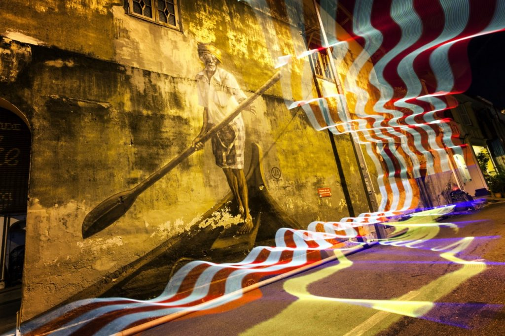 The light painting in this photo further reinforces that this street art is in Malaysia.