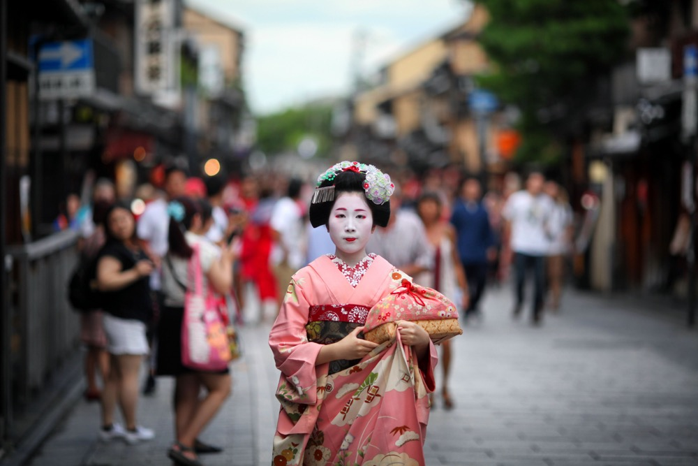 A Maiko walks along the street in Gion in Kyoto. This is one of the best creative photos Simon Bond took in 2018.