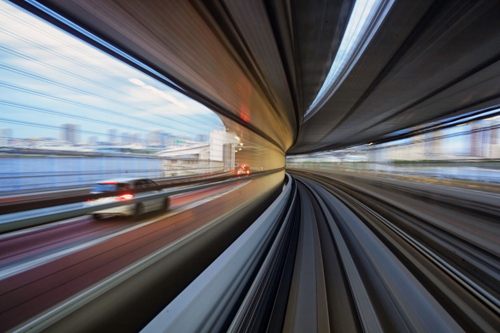 A motion blur photo taken from a train passing along the Odaiba bridge in Tokyo. This is one of the best creative photos Simon Bond took in 2018.