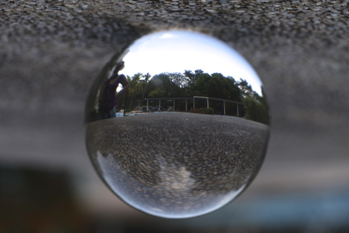 A Lensball is placed on the ground, this is not an interesting photo.