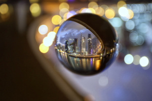 Lensball photography in Dubai. The Burj Khalifa photographed at night through a crystal ball.